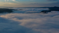 Clouds moving in german valley of river Mosel at sunrise Stock Footage
