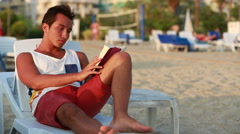 Attractive young man reading a book Stock Footage