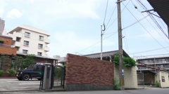 Tilt Shot Of Back Alley In Beppu Japan Daytime 4K Stock Footage