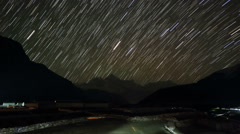Time lapse of stars behind mountain Thamserku, Kantaiga Stock Footage