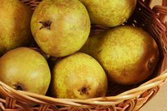 wicker basket with pears. - stock photo