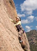 Senior lady on steep rock climb in colorado Stock Photos
