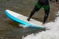 Expert stand up paddleboarder in white water Stock Photos