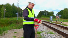 Railroad maintenance worker with shovel Stock Footage