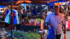 A street market with fresh vegetables and fruits in Manaus, Brazil. Stock Footage