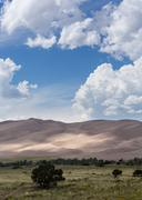 people on great sand dunes np - stock photo