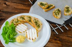 grilled camembert with baguette - stock photo