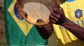 Brazilian soccer fan with the flag of Brazil. Percussion musical instrument HD Footage