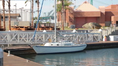 White Sailboat Moored At Dock Stock Footage