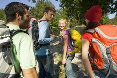 a small group of friends going trekking. - stock photo