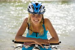 a woman wearing a cycling helmet. - stock photo