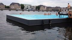 Open swimming pool located on a river Stock Footage