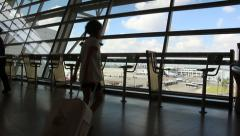 Silhouette of a young girl passenger at the airport terminal Stock Footage