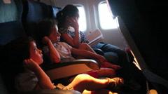 Children in an airplane during flight Stock Footage