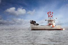 fisherboat anchoring in the baltic sea - stock photo
