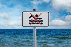 Prohibition sign on the baltic sea Stock Photos