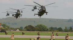 Military helicopters landing during field operations Stock Footage