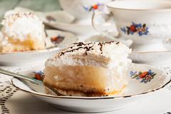 Piece of apple pie on plate Stock Photos