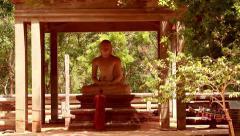 Monk praying to large Budddha_0697 - stock footage