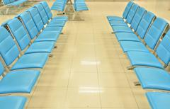 waiting room interior with chairs in airport - stock photo