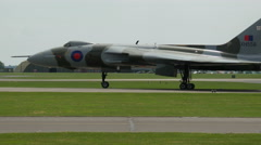 Vulcan bomber slowly moving down runway Stock Footage