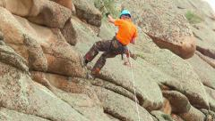 Climber descends down the cliff Stock Footage
