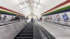 Escalators transporting commuters Stock Photos