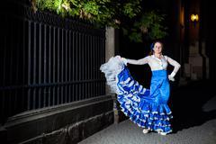 flamenco dancer in old city street - stock photo