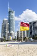 Gold Coast Surfers Paradise Q1 and beach with flag - stock photo