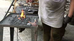 Blacksmith. Medieval tradition of making armor and swords at the forge. Stock Footage