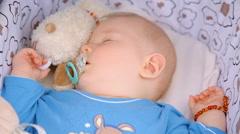 Baby boy sleeping pacifier Stock Footage