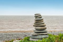 stone sculpture inukshuk - stock photo