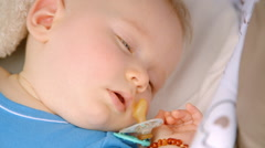 Baby boy sleeping dreaming waking up scared Stock Footage
