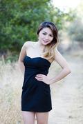 Asian american woman black dress outdoors skinny Stock Photos
