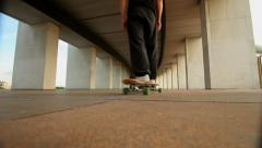 Low angle view of a guy on his longboard skate. Stock Footage