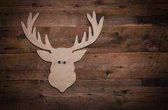 wooden christmas background with antlers or reindeer decoration. - stock photo