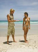 Couple having an argument on the beach. Stock Photos