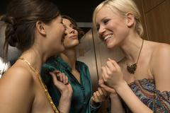 Women chatting in the restroom. Stock Photos
