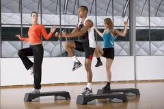 People doing step aerobics. Stock Photos