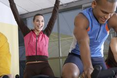 People on the cycles in the gym. Stock Photos