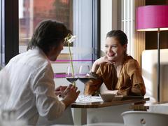 Couple at a restaurant. Stock Photos