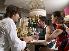 friends at a restaurant. - stock photo