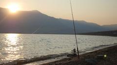 Fishing pole during sunrise Stock Footage