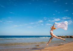 Carefree girl on the beach Stock Photos