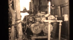 1938 oil drilling , petroleum, drill motor - stock footage