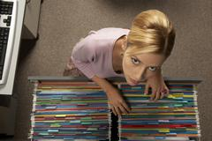 Portrait of a businesswoman searching a file in a filing cabinet drawer Kuvituskuvat