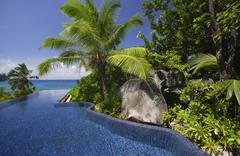 Swimming pool and palm trees of the Banyan Tree Hotel, Anse Intendance, Mahe', Stock Photos