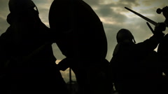 Medieval battle with thunder lightnings. Silhouettes with swords,axes,shields Stock Footage