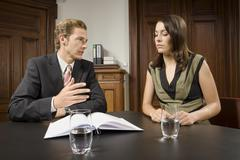 Businesspeople arguing in meeting Stock Photos