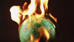 Setting a globe on fire Stock Footage